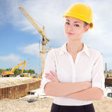 Portrait of business woman architect in yellow builder helmet Stock Images