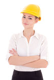 Portrait of business woman architect in yellow builder helmet  i Stock Photo