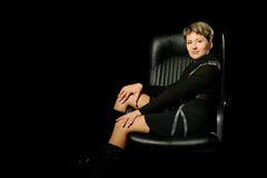 Portrait of the business woman in armchair Stock Photos