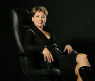 Portrait of a business woman in an armchair Stock Photos