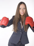 Portrait of business woman boxing in red gloves. business activity Royalty Free Stock Photography