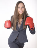 Portrait of business woman boxing in red gloves. business activity Stock Photography