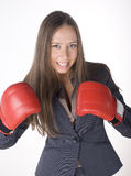 Portrait of business woman boxing in red gloves. business activity Royalty Free Stock Images