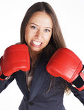 Portrait of business woman boxing in red gloves. business activity Stock Images