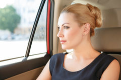 Portrait of business woman in car Stock Images