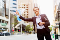 Portrait of business woman catching taxi Stock Photo