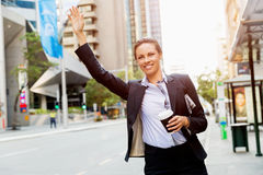 Portrait of business woman catching taxi Royalty Free Stock Images