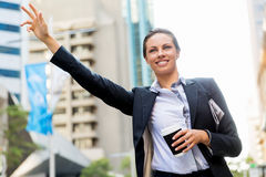 Portrait of business woman catching taxi Royalty Free Stock Photo