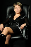Portrait of the business woman in a chair Royalty Free Stock Images