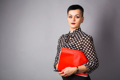 Portrait of business woman or creative professional. Grey background, with copy space. Royalty Free Stock Photography