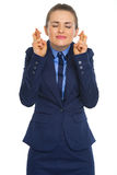 Portrait of business woman with crossed fingers Stock Photography