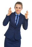 Portrait of business woman with crossed fingers Stock Photo