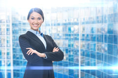 Portrait of business woman with crossed hands Stock Photography