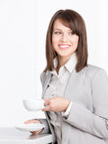 Portrait of business woman with cup and saucer. Portrait of business woman with white cup and saucer, isolated on white Stock Photo