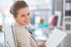 Portrait of business woman with documents. In office Royalty Free Stock Photo