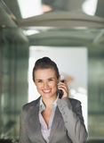 Portrait of business woman in elevator Royalty Free Stock Photo