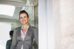 Portrait of business woman in elevator Royalty Free Stock Images