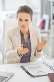 Portrait of business woman explaining something. Portrait of business woman in office explaining something Stock Images