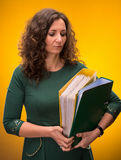 Portrait of  business woman with  folders Royalty Free Stock Photos
