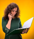 Portrait of  business woman with  folders and phone Royalty Free Stock Photos