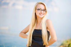 Portrait of a business woman with glasses. Portrait of a beautiful woman outdoors royalty free stock images