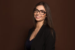 Portrait of a business woman with glasses and a black suit Stock Images
