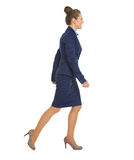 Portrait of business woman going sideways Royalty Free Stock Image