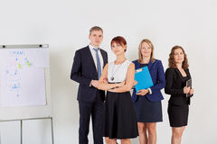 Portrait business woman with his business, positeve team. Group of business people after the meeting. Royalty Free Stock Photography