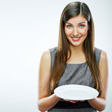 Portrait of business woman hold empty white plate. Stock Photography