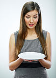Portrait of business woman hold empty white plate. Royalty Free Stock Images