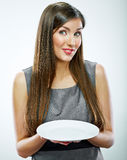 Portrait of business woman hold empty white plate. Royalty Free Stock Image