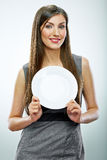 Portrait of business woman hold empty white plate. Stock Photo