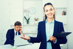 Portrait of  business woman holding cardboard in office Stock Photos
