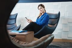 Portrait Serious Businesswoman Looking At Camera In Office Waiting Room royalty free stock images