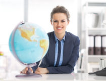 Portrait of business woman holding earth globe. Portrait of happy business woman holding earth globe royalty free stock images
