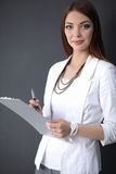 Portrait of a business woman holding  folder , Stock Photo