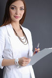 Portrait of a business woman holding  folder , Stock Photography