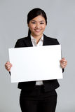 Portrait of a business woman holding a sign Royalty Free Stock Photography