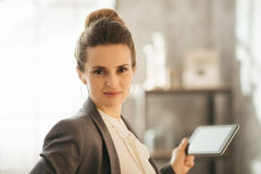 Portrait of business woman holding tablet in loft apartment Royalty Free Stock Photos