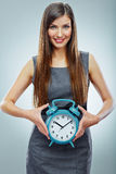 Portrait of business woman holding watch. Stock Photo