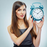 Portrait of business woman holding watch. Stock Images