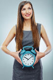 Portrait of business woman holding watch. Stock Image