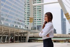 Portrait of business woman leader looking far away at outdoor public Royalty Free Stock Images