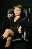 Portrait of the business woman in a leather chair Stock Image