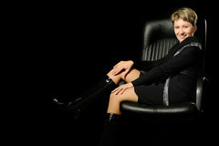 Portrait of the business woman in a leather chair Royalty Free Stock Photos
