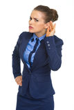 Portrait of business woman listening Stock Photography