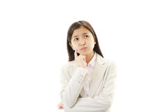 Portrait of business woman looking uneasy. Stock Images