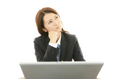 Portrait of business woman looking uneasy. Royalty Free Stock Photo