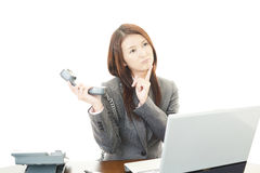 Portrait of business woman looking uneasy. Royalty Free Stock Photos