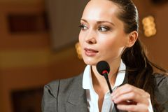 Portrait of a business woman with microphone Stock Images